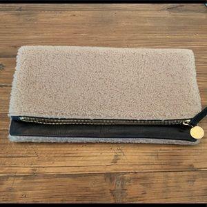 Clare V. foldover shearling/black clutch